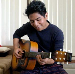 bryan-caranto-playing-the-guitar