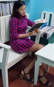 maria-elena-arambala-in-the-library