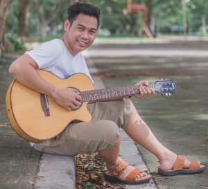 Jeric Mark Lilio with Guitar
